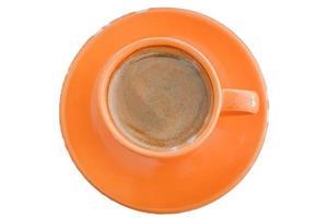 vista dall'alto di una tazza di caffè arancione