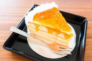 primo piano di una torta all'arancia foto