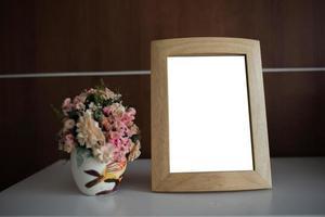 cornice per foto sul tavolo con copia spazio