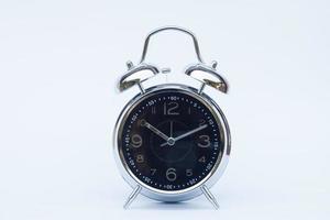 orologio su uno sfondo bianco foto