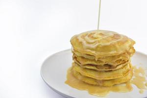 pancake con copertura di latte condensato foto