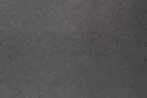 sfondo grigio da un materiale tessile con motivo in vimini, primo piano.