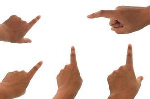 mani che puntano sulla superficie bianca