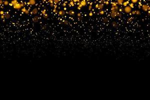 cerchi d'oro sfocati su sfondo nero foto