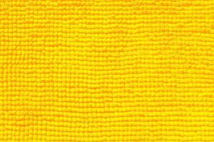 primo piano di asciugamano giallo per texture o sfondo