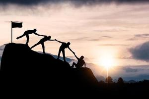 silhouette di successo del lavoro di squadra foto