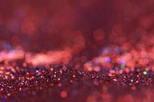 sfondo rosso scintillante e bokeh foto