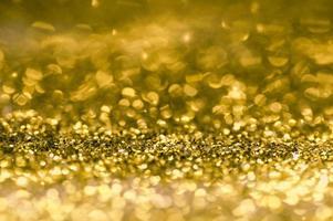 oro scintillante e sfondo bokeh foto