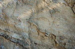 la trama di un vecchio muro di pietra foto