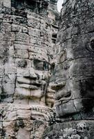 antiche facce di pietra al tempio di Bayon, Angkor Wat, Siam Reap, Cambogia