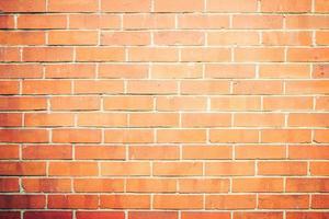 vecchio muro di mattoni di pietra sullo sfondo foto