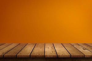 parete arancione e tavolo in legno foto