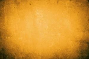 cemento giallo e arancione o muro di cemento per lo sfondo o la trama foto