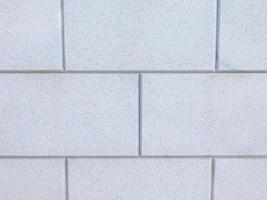 muro di mattoni grigi per lo sfondo o la trama foto