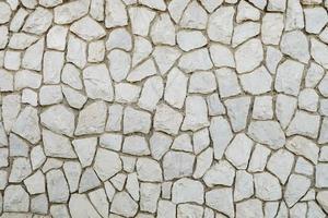 muro di mosaico di mattoni bianchi foto