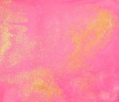 trama di vernice rosa e oro foto