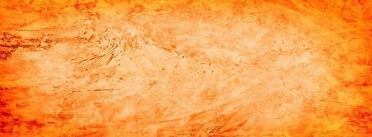 fondo arancio della parete di struttura del cemento del grunge foto