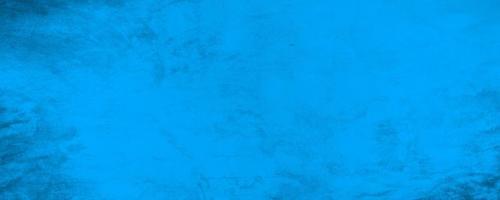 Fondo blu scuro orizzontale del muro di cemento di struttura foto