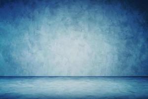 sfondo blu scuro dello studio del muro di cemento del grunge foto
