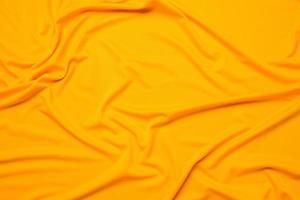 trama del tessuto giallo foto
