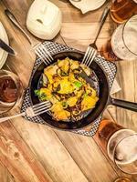 laici piatta di nachos su un tavolo foto