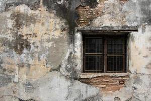 fondo di struttura del muro di cemento incrinato foto
