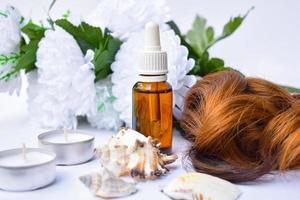 cornice della cura dei capelli con olio di argan, sfondo del prodotto foto