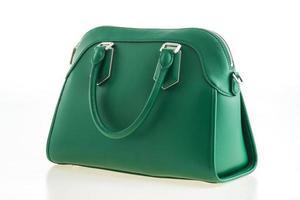 bella eleganza e borsetta verde moda di lusso foto