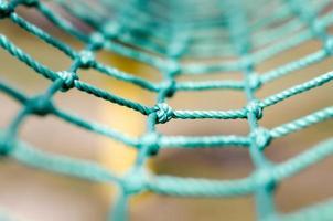 primo piano della corda di maglia verde foto