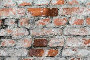 consistenza del muro di mattoni usurati foto