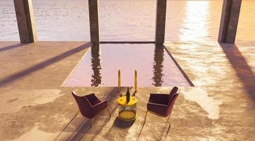 piscina con bicchieri da vino e sedili in seta su un tramonto