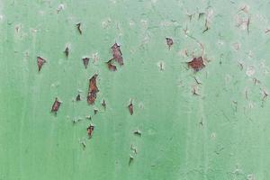 parete esterna verde scheggiata foto