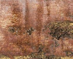 muro marrone graffiato arrugginito foto