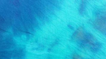 superficie in tessuto tie dye sfumato in turchese blu foto
