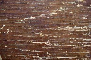 vecchia superficie di legno con crepe e vernice foto