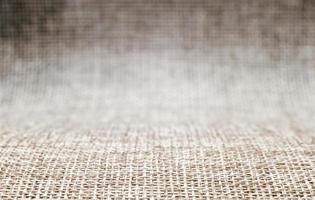motivo di sfondo bianco di stuoie di tessuto ruvido in sfocatura, macro da vicino foto