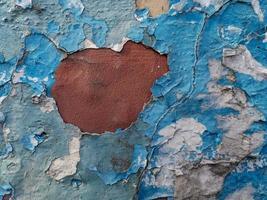 sfondo blu con pittura ad olio incrinata su intonaco. foto