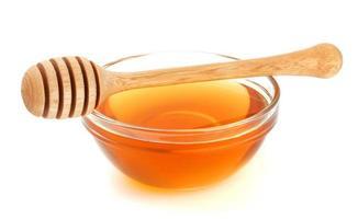 miele isolato su sfondo bianco foto