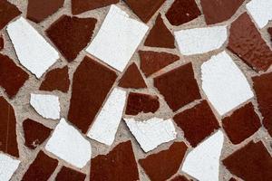 vecchio muro di pietra con motivo astratto da vicino foto