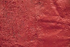 astratto sfondo rosso trama vecchio muro di cemento foto