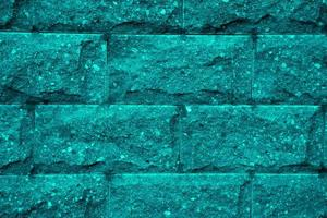 primo piano del fondo di struttura del muro di mattoni blu foto