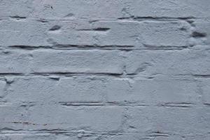 vecchio primo piano del fondo di struttura del muro di mattoni bianchi foto