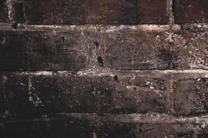 primo piano del fondo di struttura del vecchio muro di mattoni foto