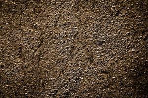fondo di struttura dell'asfalto dell'oro foto