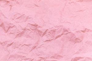 trama di sfondo di carta stropicciata mestiere rosa foto