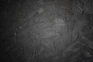 grunge scuro e nero e cemento texture o sfondo concreate foto