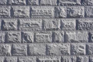 il muro di blocchi di granito è come uno sfondo foto