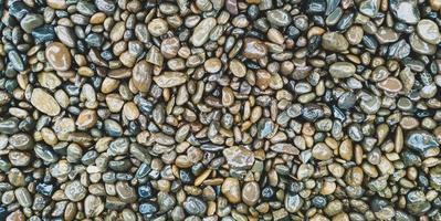 rocce bagnate e priorità bassa di struttura di pietra foto