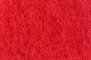 trama astratta della superficie rossa di un asciugamano foto
