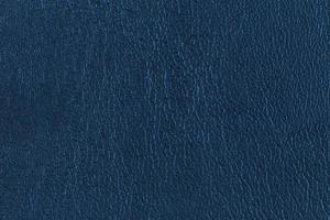 primo piano della superficie del fondo di struttura di cuoio blu scuro foto